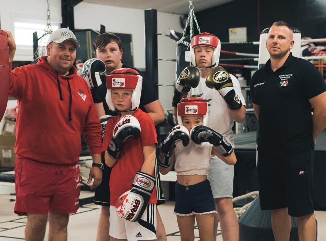Adam Bradley and Wade Cooper with young boxers Drew, Callum and Amelia. Photo: Thom Bartley