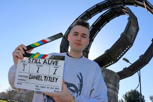 Daniel Titley at the memorial statue to James Whale outside Showcase Cinema at Castle Gate in Dudley.