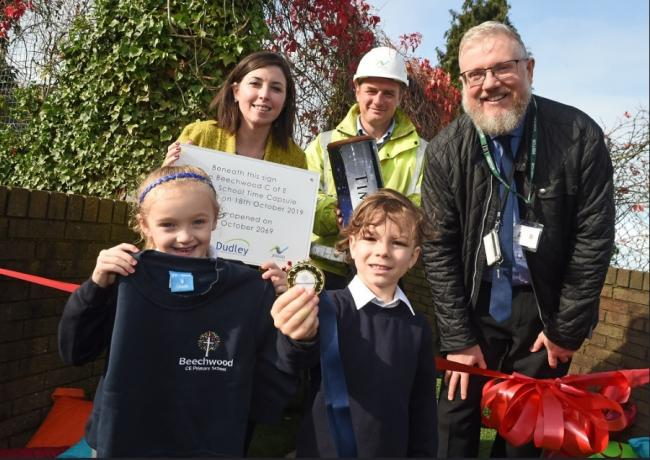 Children from Beechwood C of E Primary School with from left to right: Sophie Blick, deputy headteacher at Beechwood C of E Primary School, Austin Russell, site manager for Jessup Brothers and Andy Timmins from Dudley Council.