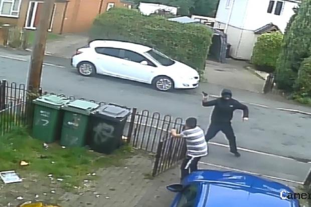 TERROR: Tommy Lee Jauncey shoots the pistol. Photo: West Mercia Police