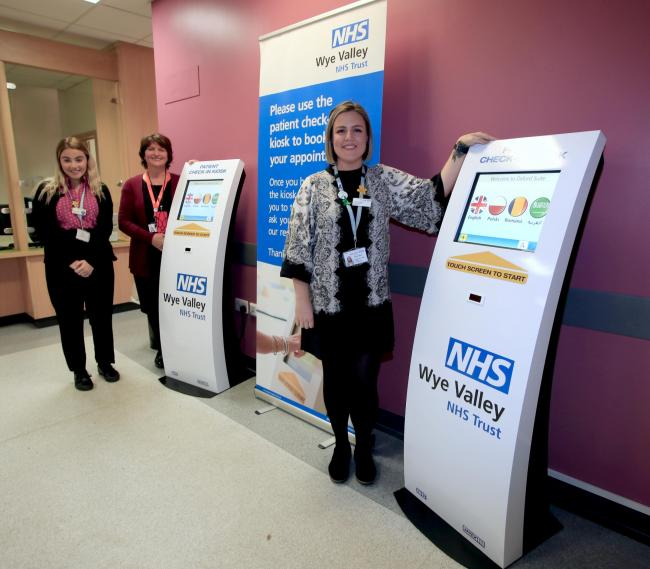Receptionist Evie Crawford, project lead Shirley Michael and Oxford Suite outpatients team leader Tanya Probart pictured with new check-in kiosks at Hereford County Hospital.