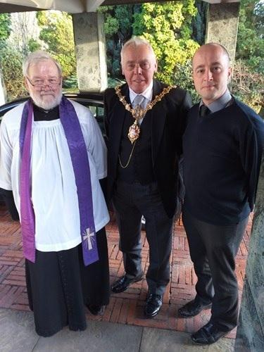 The Mayor of Dudley, Councillor David Stanley, with Father Oakes and Ian Bailey (right), principal bereavement services officer at Dudley Council