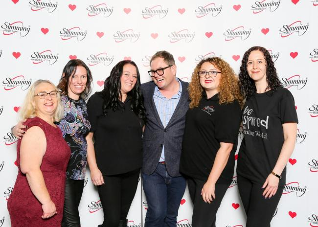 Dudley Slimming World consultants Donella Russell, Deb Tandy, Natalie Howard, Vinny Johnson and Emma Miller with Chatty Man Alan Carr.