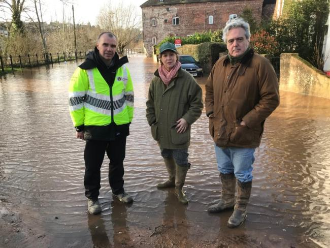 Environment Agency flood risk manager Anthony Perry, Minister for Environment Rebecca Pow and Wyre Forest MP Mark Garnier in Bewdley on Sunday