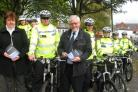 Councillors Bryan Cotterill and Lynda Coulter with the police officers show off their new kit