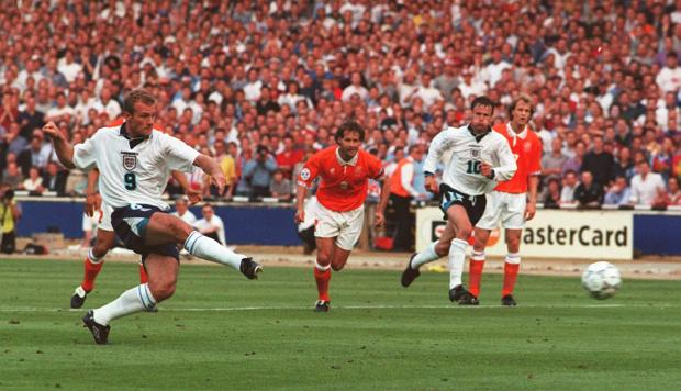 Dudley News: GOAL: Alan Shearer scores from a penalty to open the scoring for England in tonight's Euro 96 clash against Holland at Wembley. Picture: Neil Munns/PA