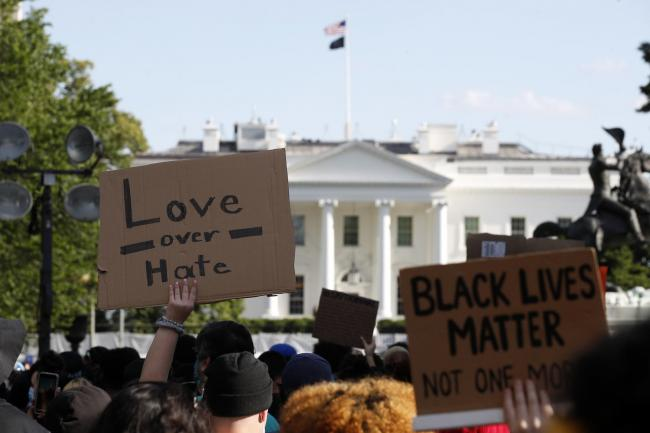 PROTEST: Demonstrators gather outside the White House. Pic. AP Photo/Alex Brandon.
