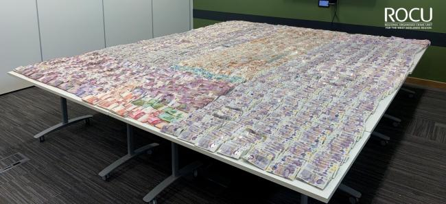 Some of the haul of cash seized during the operation. Photo: West Midlands Police.