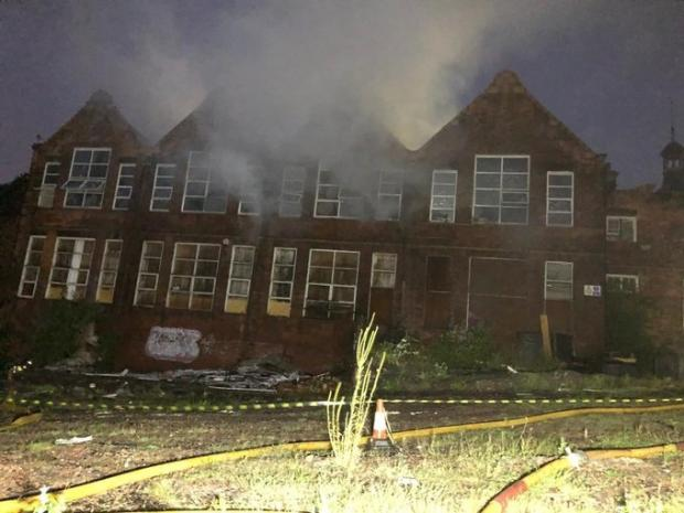 Dudley News: The former school building in Blowers Green Road, Dudley, where firefighters worked through the night to fight the flames. Pic - West Midlands Fire Service