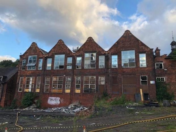 Dudley News: The former Sir Gilbert Claughton School after a fire ravaged the building in July. Pic - West Midlands Fire Service