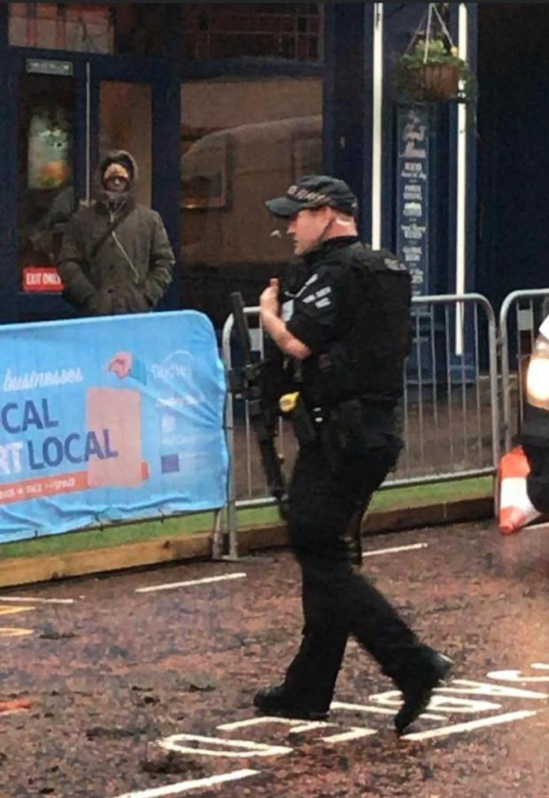 Dudley News: An armed officer pictured at the scene in Dudley High Street