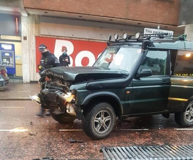 A battered Range Rover pictured at the scene in Dudley High Street