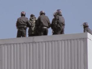 Charges dropped for EDL rooftop protestors
