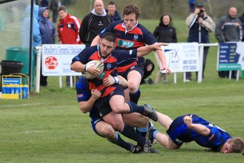 Prop Rich Kelley is tackled against Syston