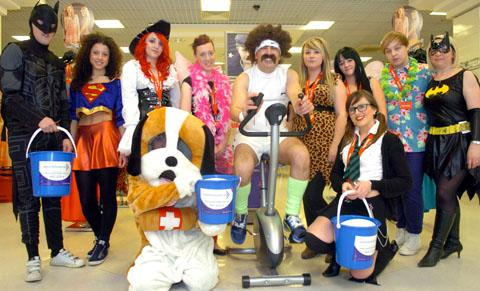 Steve Morfoot with staff from TK Maxx in fancy dress in aid of Cancer Research. Buy photo: 191215K