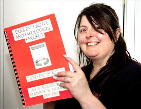 Presentation Assistant Amy Hickman with the book that was returned to Dudley Zoo 21 years after a history student borrowed it.