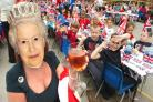 School head Wendy Briscoe dons a Queen Elizabeth mask for the celebrations. Buy photo: 241228L