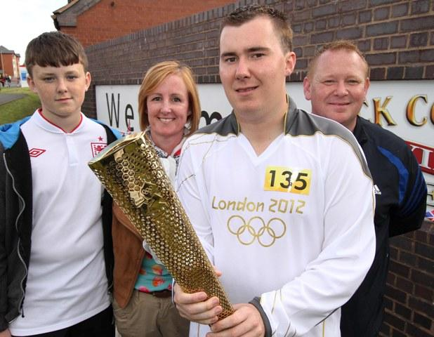 Torch bearer Ross Ensor with his proud family - Callum, Rachel and Paul - photo by Aaron Manning