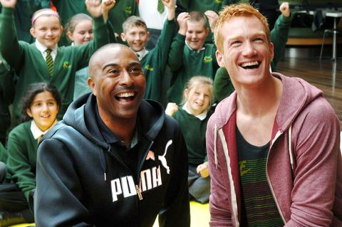 Colin Jackson and Greg Rutherford with Ashwood Park Primary Pupils. Buy photo: 281209LA