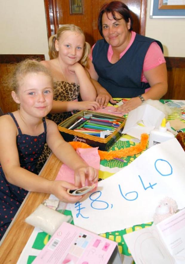 Isabelle Philips (8), Molly Handley (9), with Tracey Guy.Buy photo: 311217M