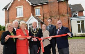 1.	Impressive home: Kidderminster Mayor  John Aston cuts the ribbon to officially open The Briars,