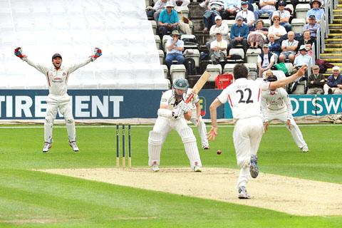 THAT'S OUT: Worcestershire Cricket Club's James Cameron falls LBW off the bowling of Lancashire's Kyle Hogg.