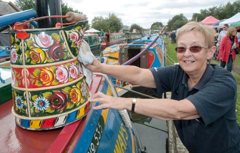 Joan Blackley of the Canal & River Trust cleaning her boat 'Leo' - a traditional Butty. Buy photo: 391203MH