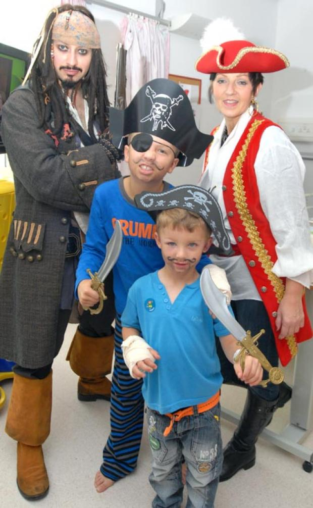 Captain Jack Sparrow (aka Lee Bradley), Ben Price, aged 11, Tyler Ricketts, aged 4 with face painter Karen Evetts. Buy photo: 391240M