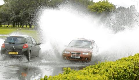 Warning to drivers to take care as floods affect Midlands roads