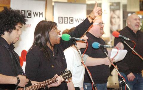 80s singer Jaki Graham with Radio WM presenters busk at Merry Hill. Buy photo: 411202L