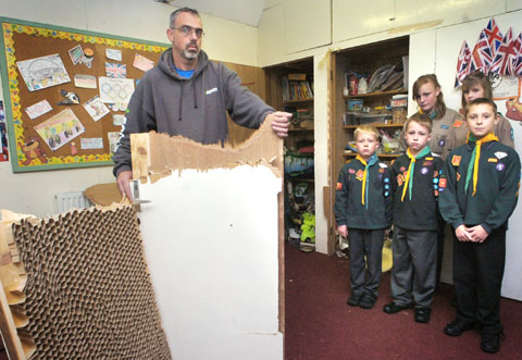 Scout group leader Andy Garratt with a broken cupboard door and scouts Dylan Passmore, William Passmore, Kyle Skidmore, Skye Timmins and Jodie Hickman. Buy photo: 411207L.