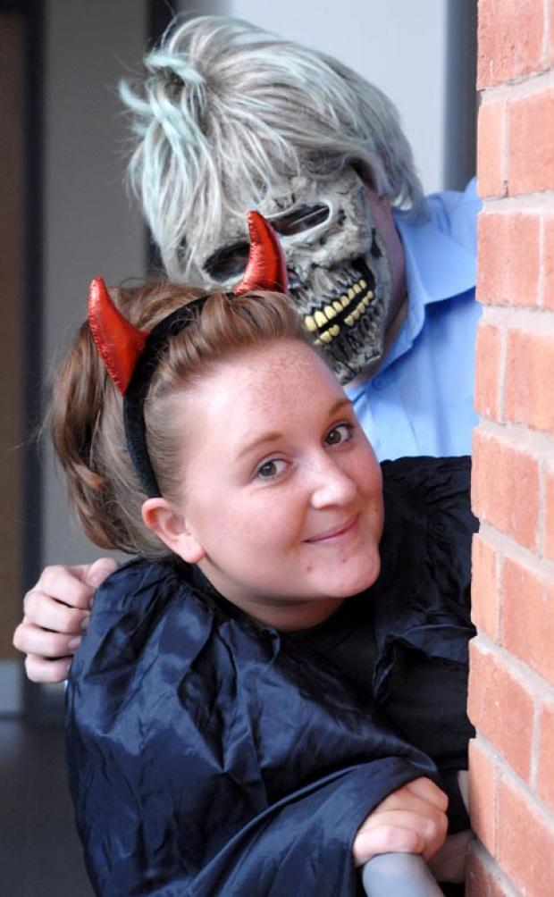 Getting into the Halloween spirit are Hannah Blake and John Walters. Buy photo: 411247M