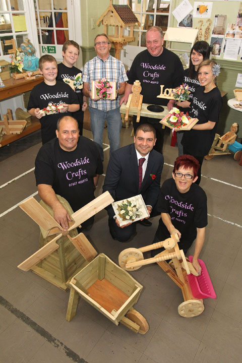 Cllr Qadar Zada, centre, with members of Woodside Crafts - Daniel Sault (9), Stephen Sault (11), Don Neale, director Bryan Sault , Vicky Marston (16) and Lydia George (16) director Martin Marston and director Chris George. Buy photo: 441222J