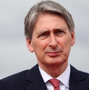 Defence Secretary Philip Hammond has been told he is not listening in Dudley TA row