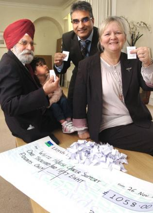 Gurcharan Singh Bedi with granddaughter Sonu (18 months,) Cllr Khurshid Ahmed and Andrea Pope-Smith draw raffle tickets for prize draw. Buy photo: 491246L