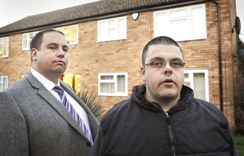 Dudley News: Bill Etheridge and Dave Simmons in front of the flat where the dog was rescued from. Buy photo: 511221L