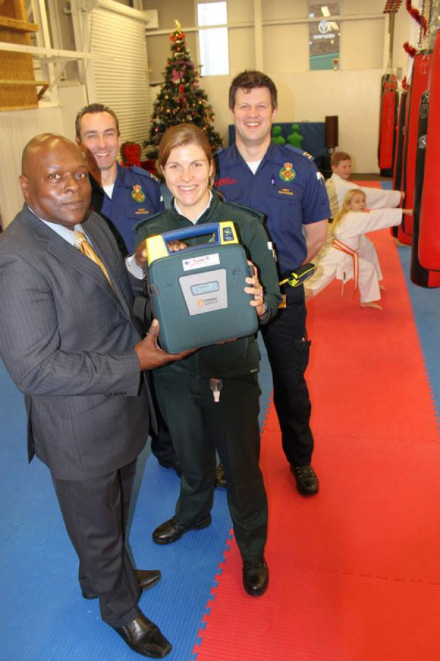 Donald Campbell from Karate Academy holding the defibrillator (front) with Emma Wilkins; Community First Responders Kevin Wright and Des O'Neil (middle); karate students Millie Wright and Ethan Donati (back).