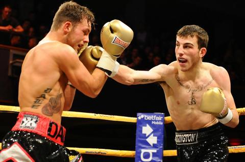 Sam Eggington looks for a way through Dale Evans' defences. Photo: www.leighdawneyphotography.com
