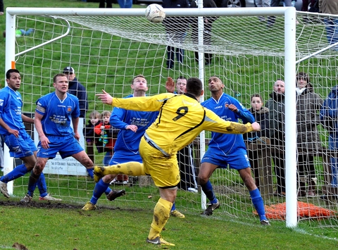 ONE IN, ALL IN: Gornal's defenders make another clearance against Bodmin