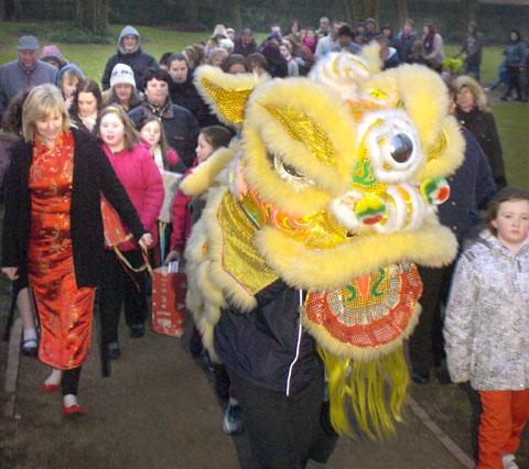 The Chinese dragon leads the Queen Victoria Primary School parade. Buy photo: 091326L