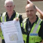 Pcs Bill Smith and Reg Steele with a copy of the new dispersal order