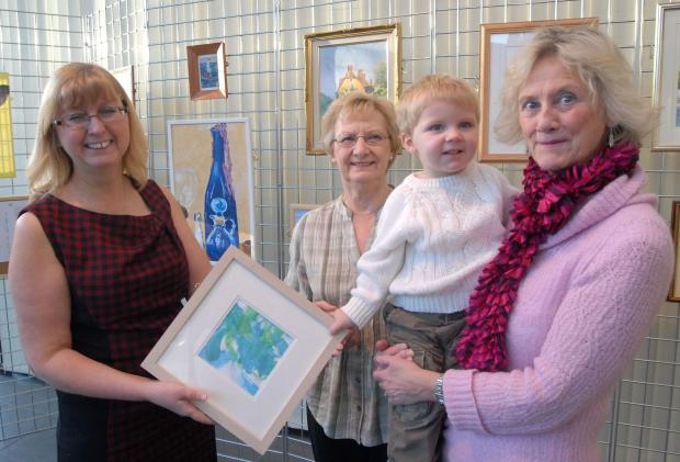 Dudley News: Brierley Hill Society of Artists exhibition at the cone: l-r Lillian Goodwin, Ena Baker, Oliver Jones, aged two and Helen Brettle. Buy this photo: 041401M.