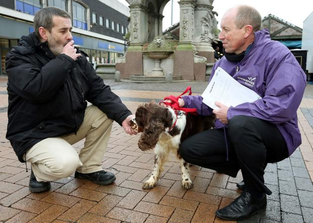 Dudley News: Stop smoking Sniffy the sniffer dog encouraging people to stop smoking in Dudley town centre. L/R Martin Griffin with Neil Tonks, smoking cessation advisor for Dudley Stop Smoking Campaign 041416JH