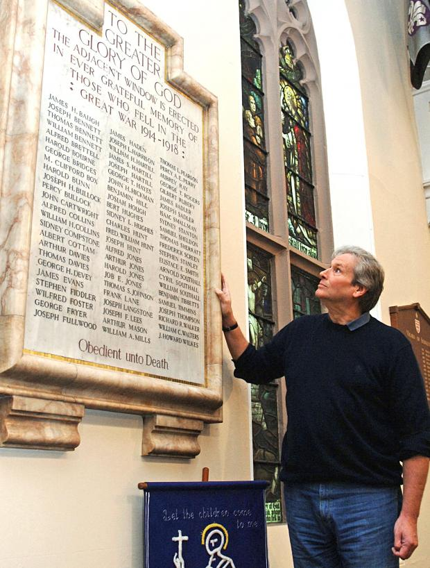 Dudley News: Martin Jones, who is appealing for memories of World War One soldiers from Sedgley, with the war memorial inside All Saints' Church