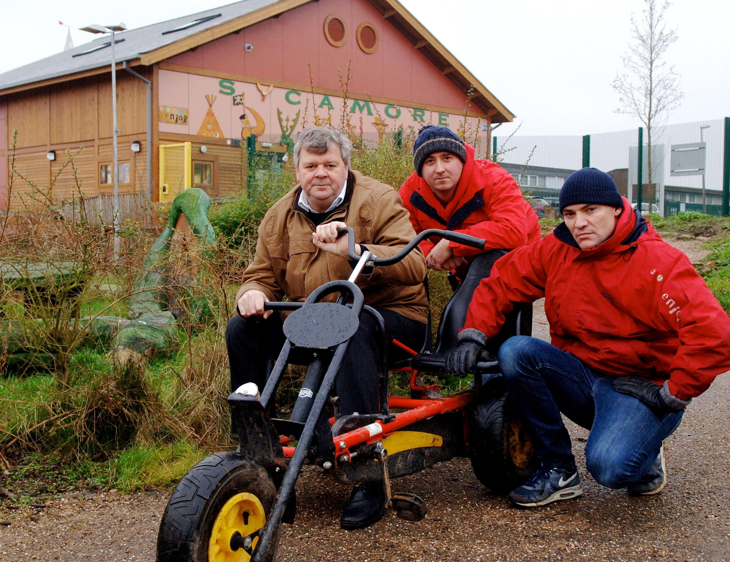 Cllr Tim Crumpton with Sycamore Centre staff Will Ganniclifft and Keith Rogers with a kart similar to items stolen from the centre