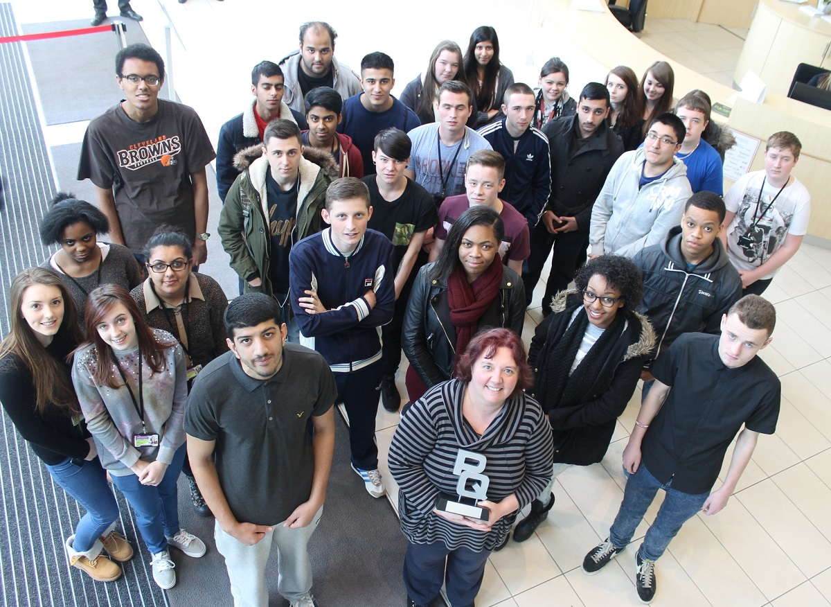 Numbers fame: BMET lecturer Fiona Williams, front centre, and accounting students celebrate becoming PQ Magazine's Public Sector College of the Year.