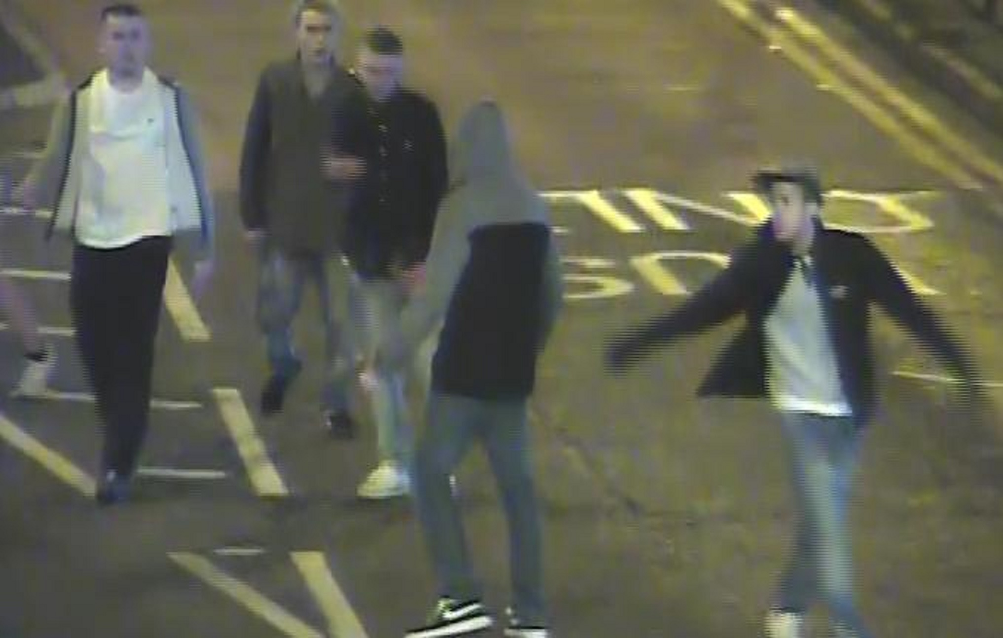 Police are keen to identify the people in this picture.