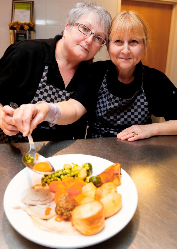 Dudley News: Beacon Centre catering assistants Elaine Hampson and Alison White get ready to dish out VIP meals