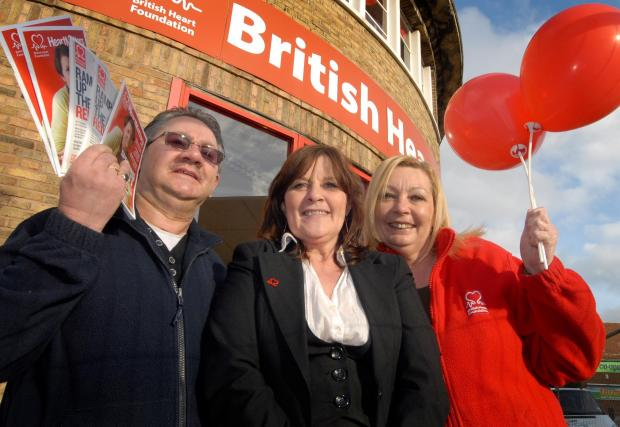 BHF shop staff Clive Bicknell (volunteer) Sharon Cronin (manager) and De