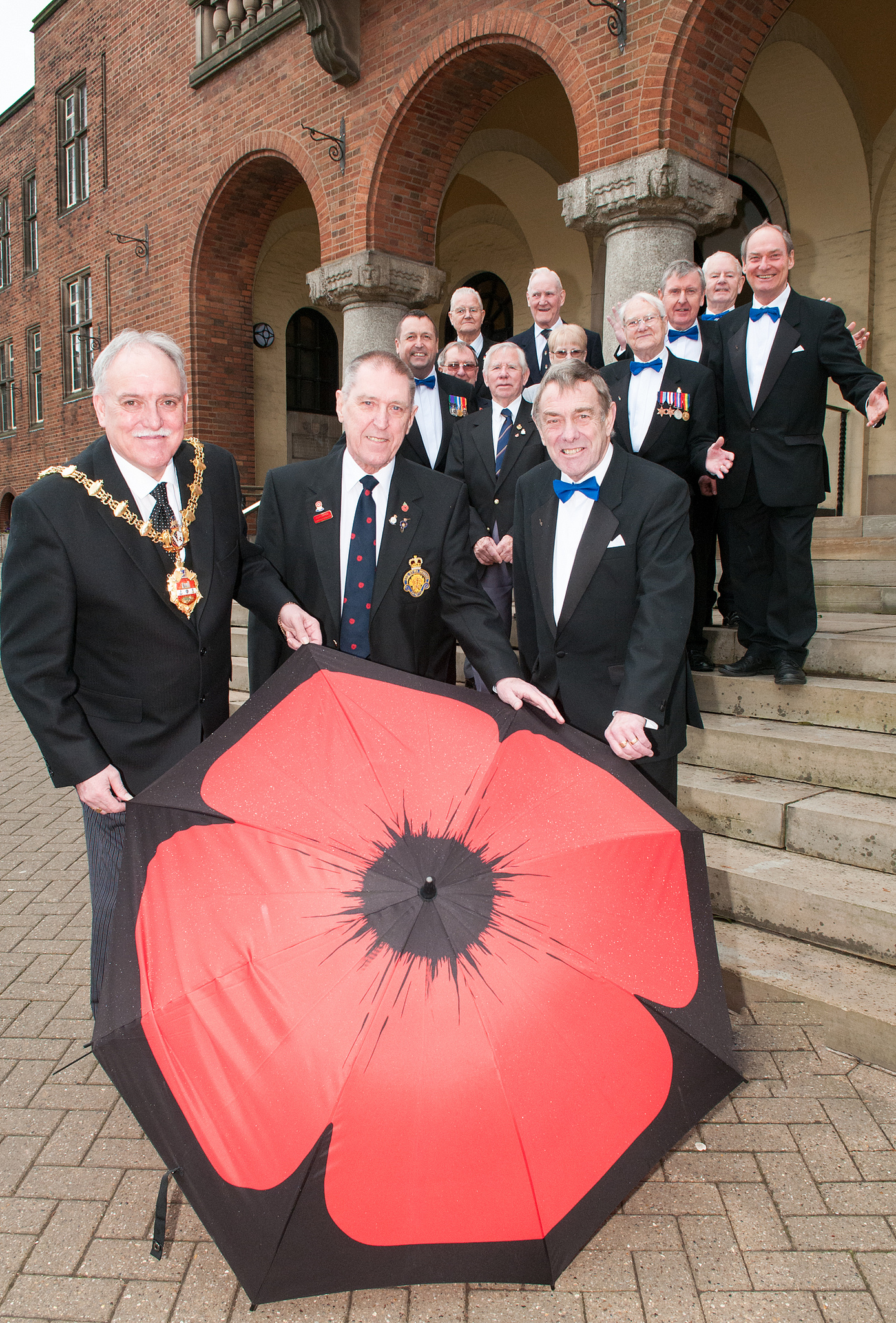 Cllr Alan Finch with Bob Townsend, Royal British Legion poppy organiser and Keith Moss, chairman of the Gentlemen Songsters Male Voice Choir.
